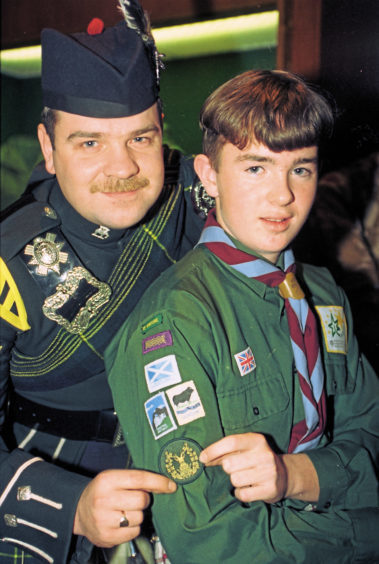 1994: Greg Nairn, 1st Kintore Scout Group with L/Cpl Kevin Douglas on a visit to the Gordon Highlanders Regimental HQ in Aberdeen