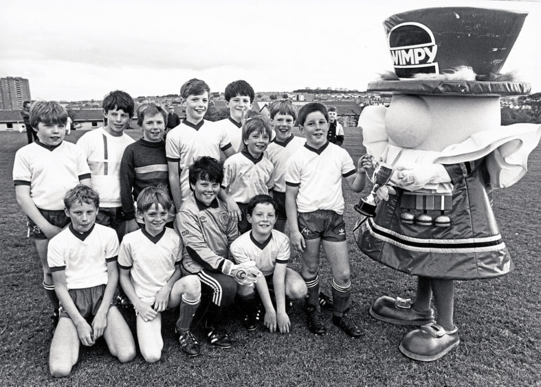 1987: 65th Milltimber Cubs football captain Michael Milne receives the Dee District Cubs Wimpy League Cup after beating 4th Aberdeen 4-2 in a play-off at Balgownie