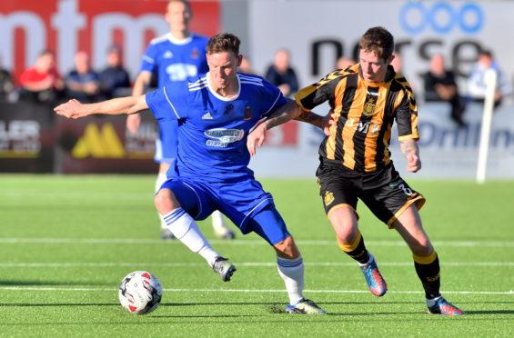 Mitch Megginson, left, in action against Auchinleck Talbot.