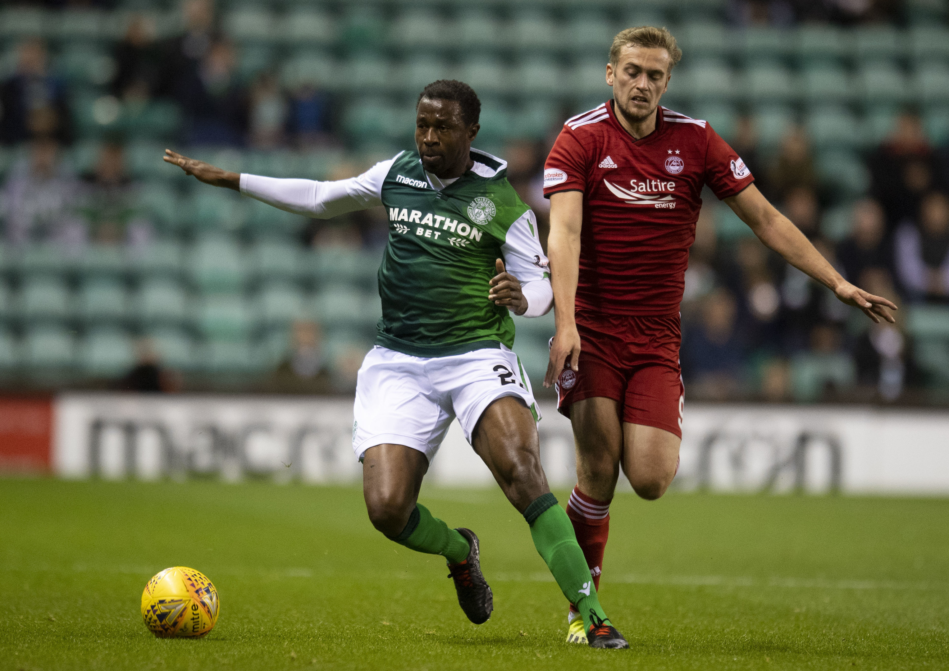 Hibernian's Efe Ambrose, left, holds off Aberdeen's James Wilson.