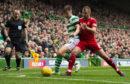Celtic's Kieran Tierney, left, holds off Aberdeen's Niall McGinn