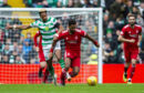 Celtic's Scott Sinclair, left, competes with Aberdeen's Shay Logan.