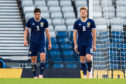 Scotland's Scott McKenna, left, and Stuart Armstrong are dejected after Portugal make it 1-0.