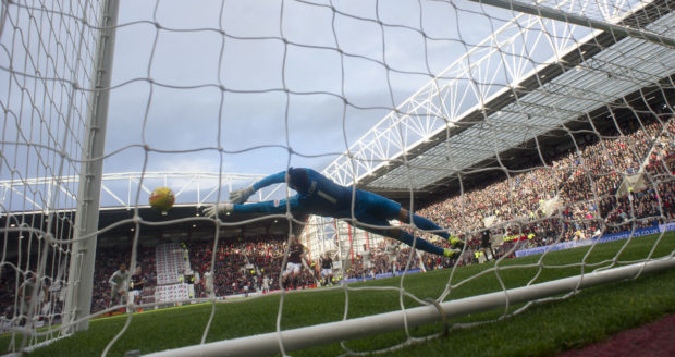 Aberdeen's Joe Lewis saves Hearts' Steven Naismith second half penalty.
