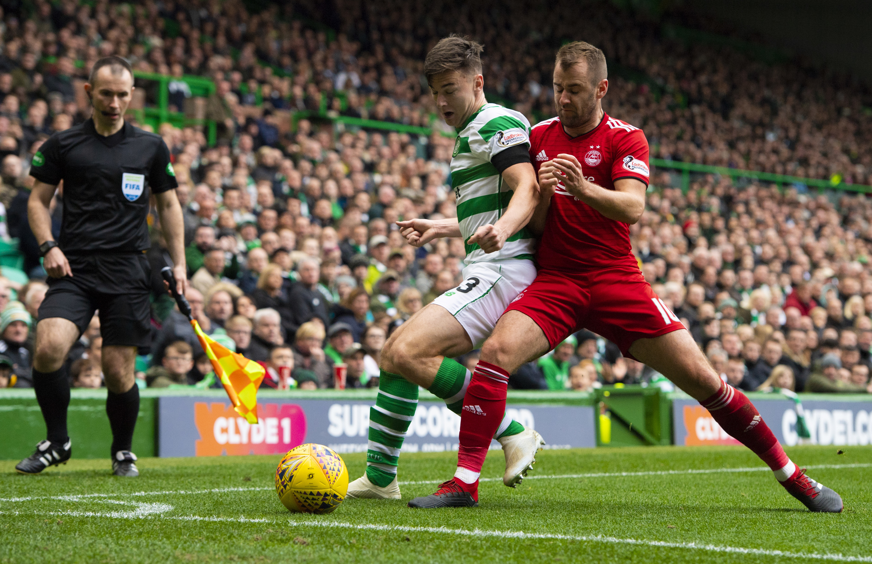 Celtic's Kieran Tierney (left) holds off Aberdeen's Niall McGinn