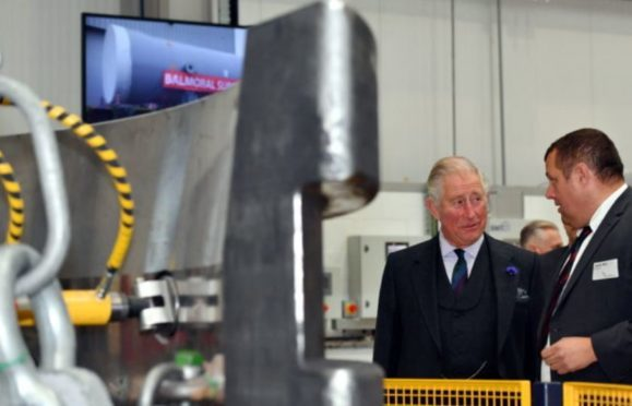 HRH Prince Charles, The Duke of Rothesay, visited Balmoral Offshore Engineering, Aberdeen to officially open the new Balmoral Subsea Test Centre. Pictured - Prince Charles is shown around the new test centre by Derek Weir