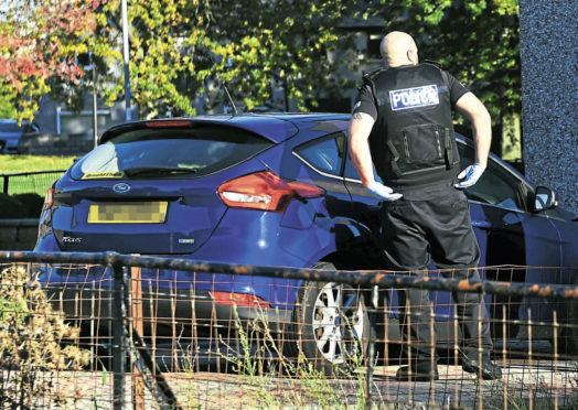 Police at the scene on Deveron Road