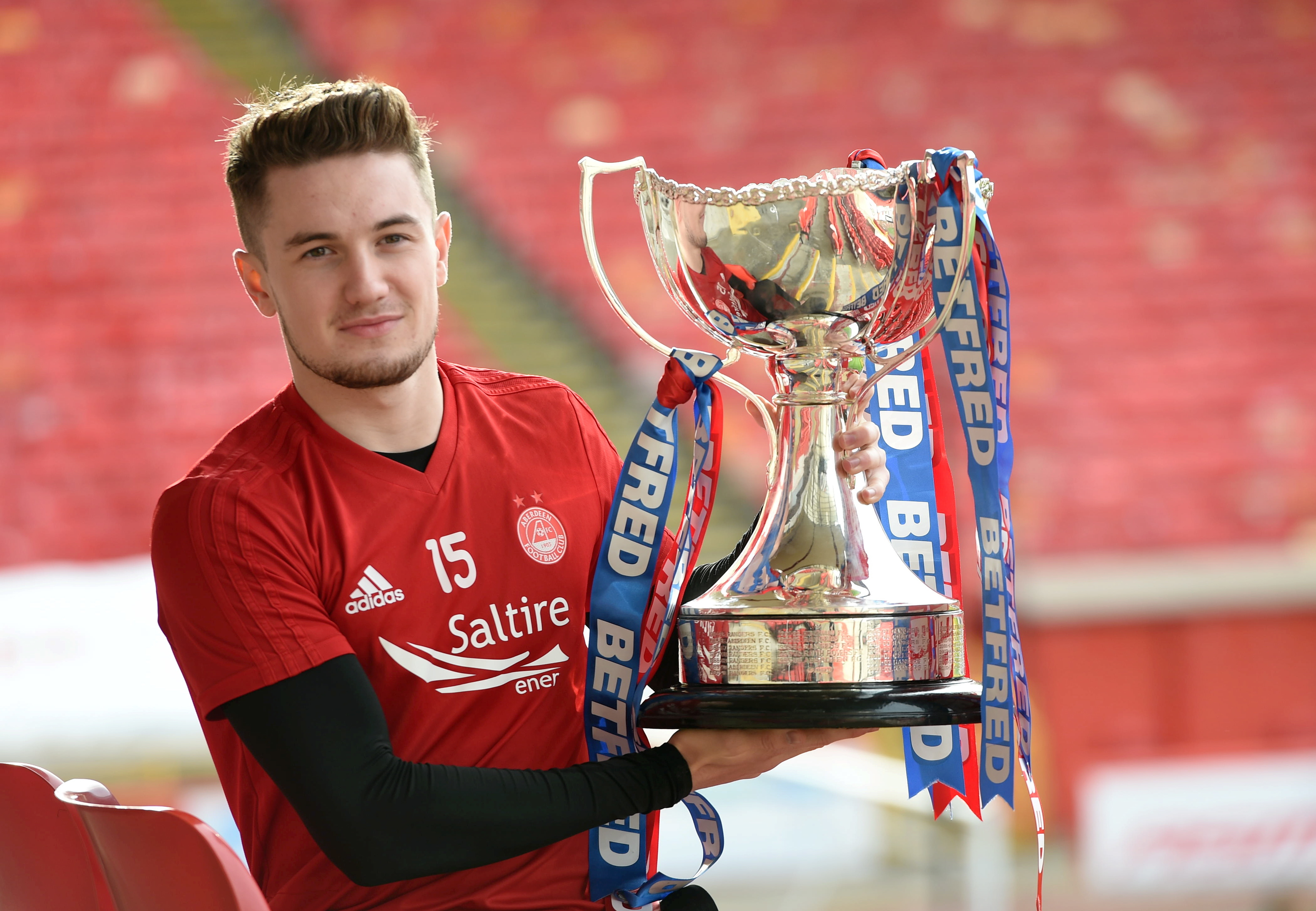 Scott Wright with the Betfred  Cup.  Picture by Darrell Benns