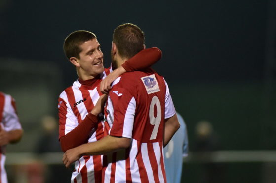 Formartine's Garry Wood (9) celebrates with team mate Jonathan Crawford after netting the opening goal against Deveronvale. Picture by Scott Baxter