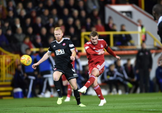 James Wilson scores to put the Dons 2-0 up