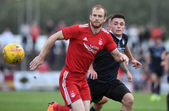 Aberdeen's Mark Reynolds and Falkirk trialist Jordan Allan compete for the ball in pre-season.