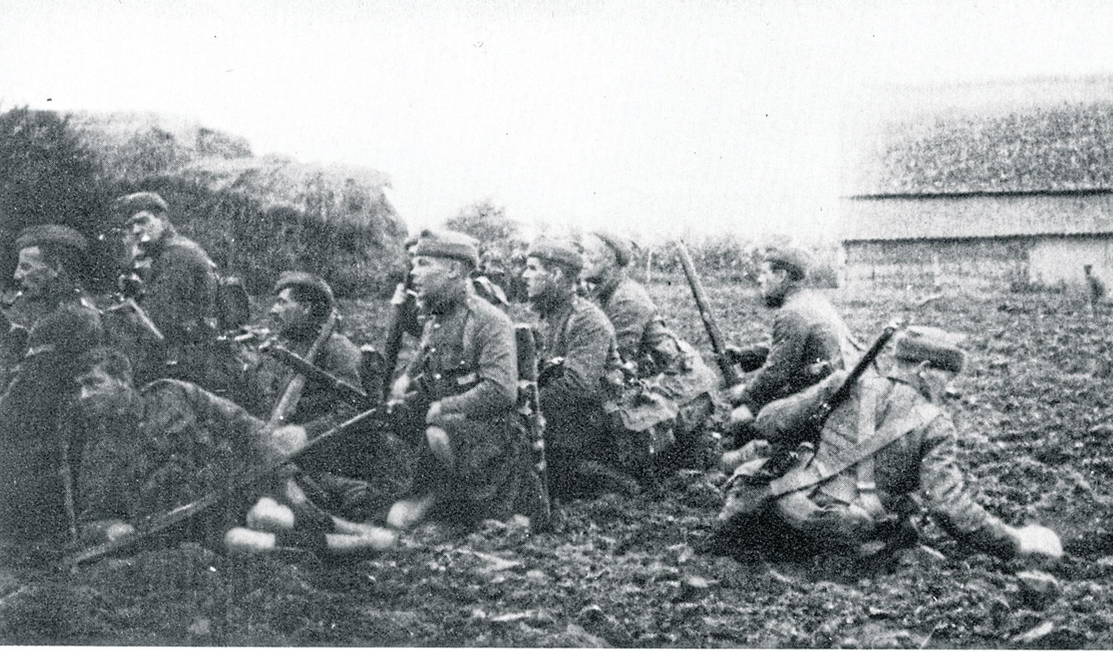 Gordon Highlanders wait on the edge of a field near Ypres