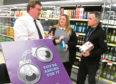 From left, Spar area manager Bill Christie, the supermarket's training manager Susan Dunn and Licensing Inspector Kenny McGeough