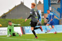 Derek Lyle scores for Peterhead.