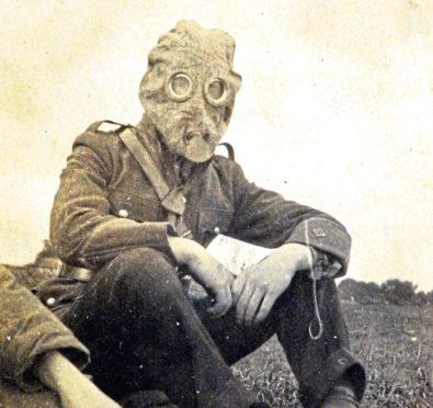 A Gordon Highlander wearing a gas mask