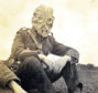 A Gordon Highlander wearing a gas mask