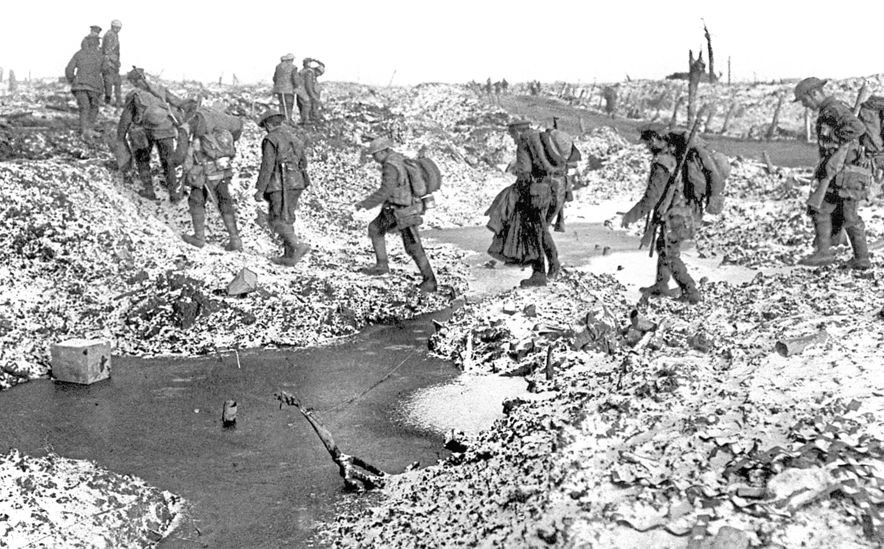 British soldiers negotiating craters near the River Somme in late 1916