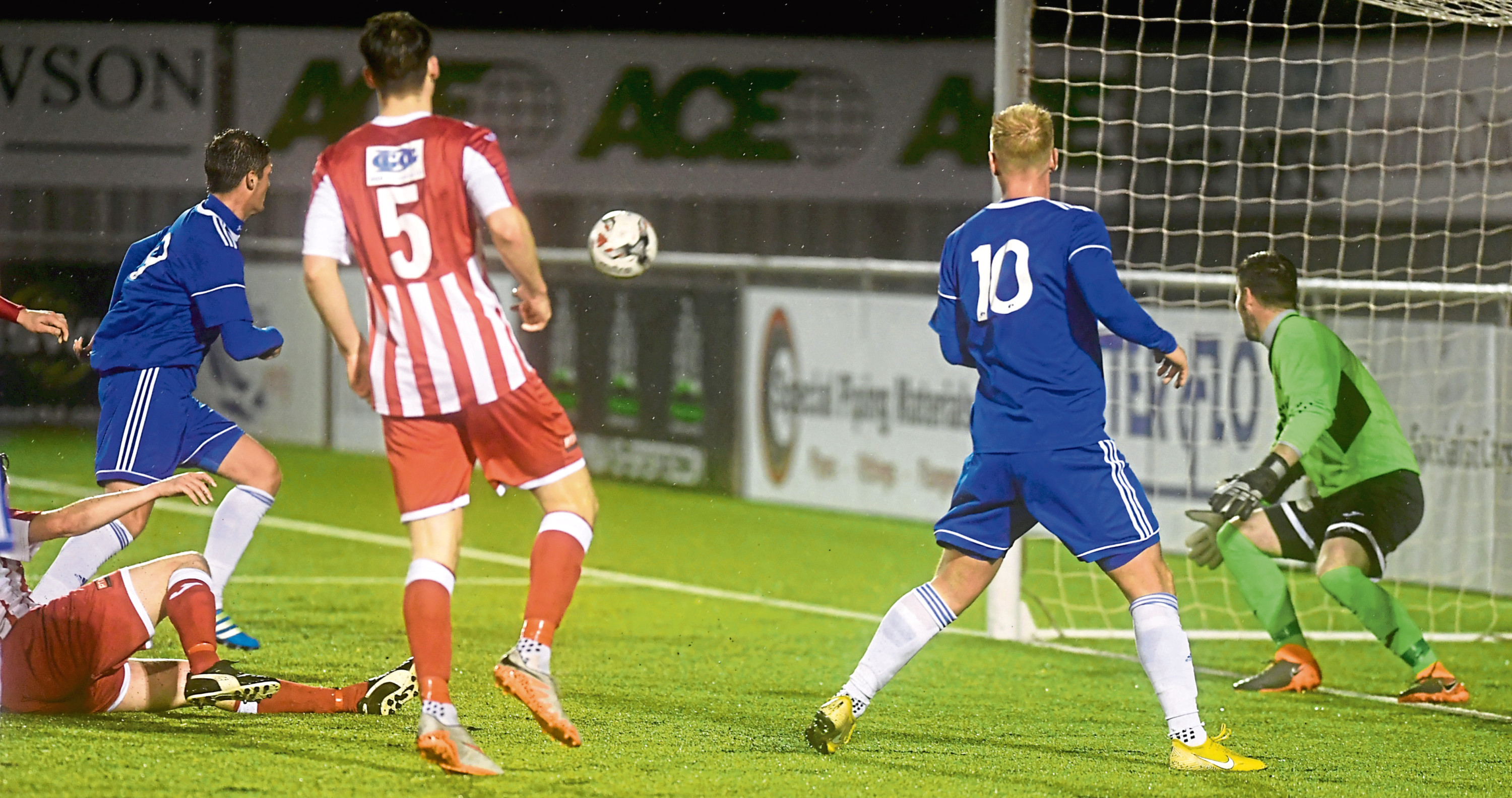 Daniel Park scores Cove's first against Formartine United in the Aberdeenshire Shield. Picture by Chris Sumner.
