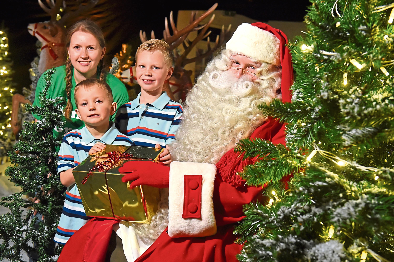 Santa, Lisa Sisson of CLAN, and brothers Kian and Adam Craik