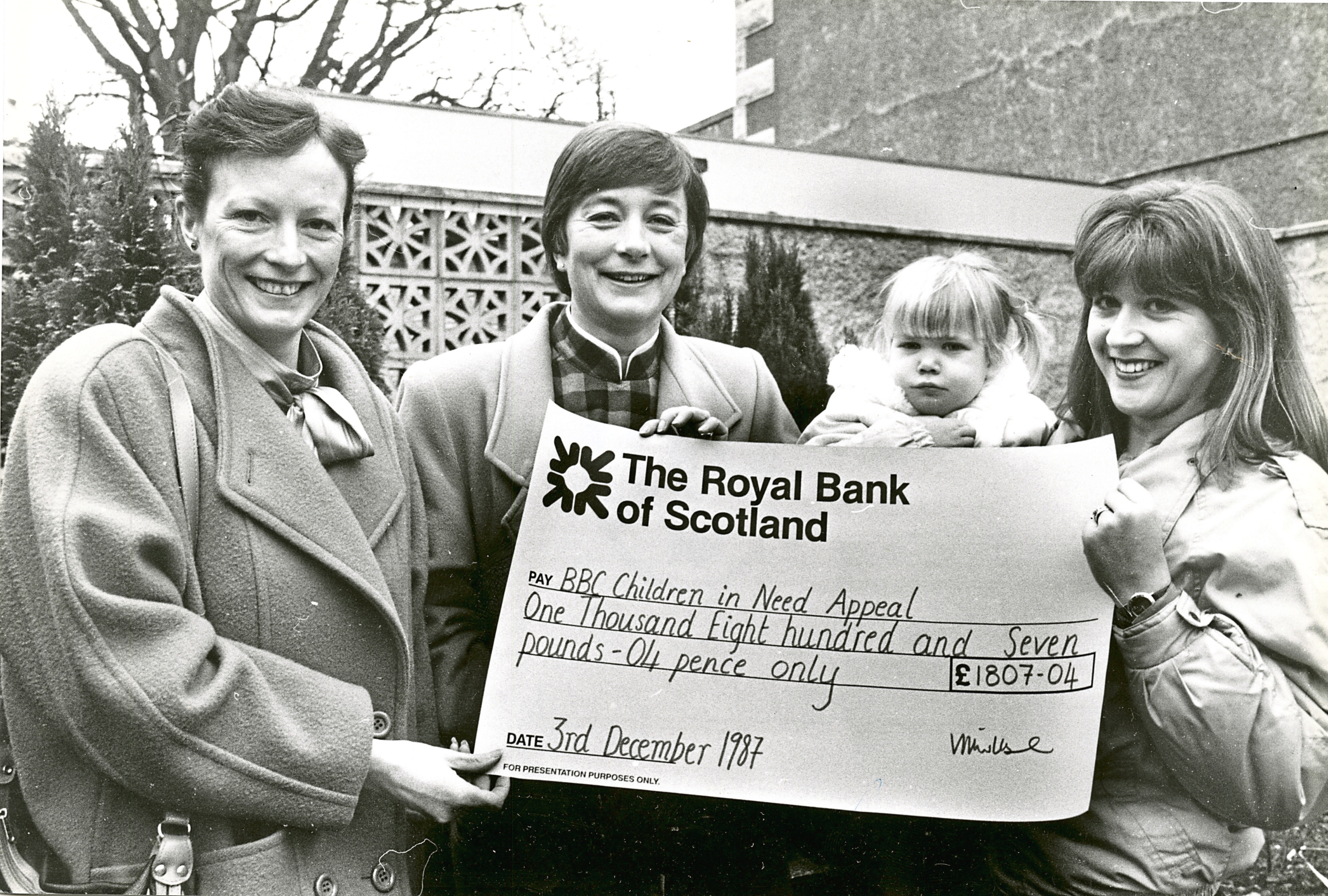 1987: Theresa Porter, Vanda Wilshire and Vanda's daughter Kimberley present BBC Scotland's Jane Franchi, second left, with a cheque for £1,800
