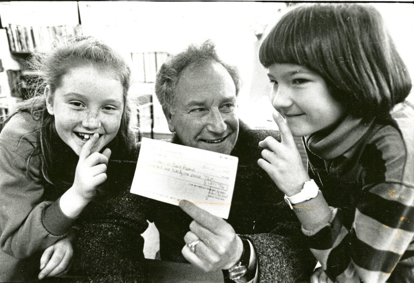 1989: BBC Broadcaster Robbie Shepherd accepts a cheque for £121 raised by pupils at Netherley School, Stonehaven, through a sponsored silence – the idea came from 10-year-old pupils Debbie Ballantyne, left, and Briony Mattingley