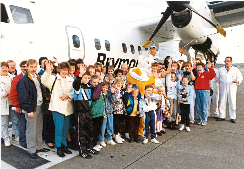 1990: Waiting to board their prize flight over Aberdeen were 36 lucky winners of a raffle in aid of Children in Need