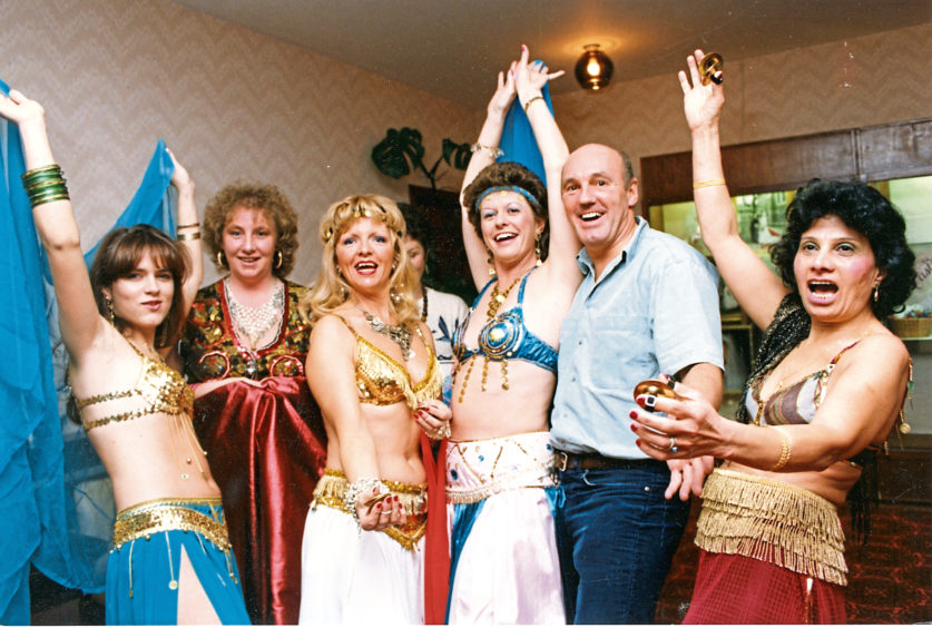 1991: Fundraising belly dancers Alfie Spencer, Vie Alexander, Shirley Howley, Barbara Kelly and Eugiene Warner at Westhill hotel with Bruce Shaw