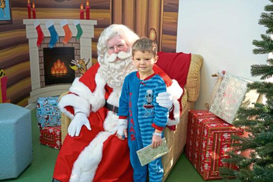Bobby-Jo Killoh, 4, with Santa at the Royal Aberdeen Children's Hospital
