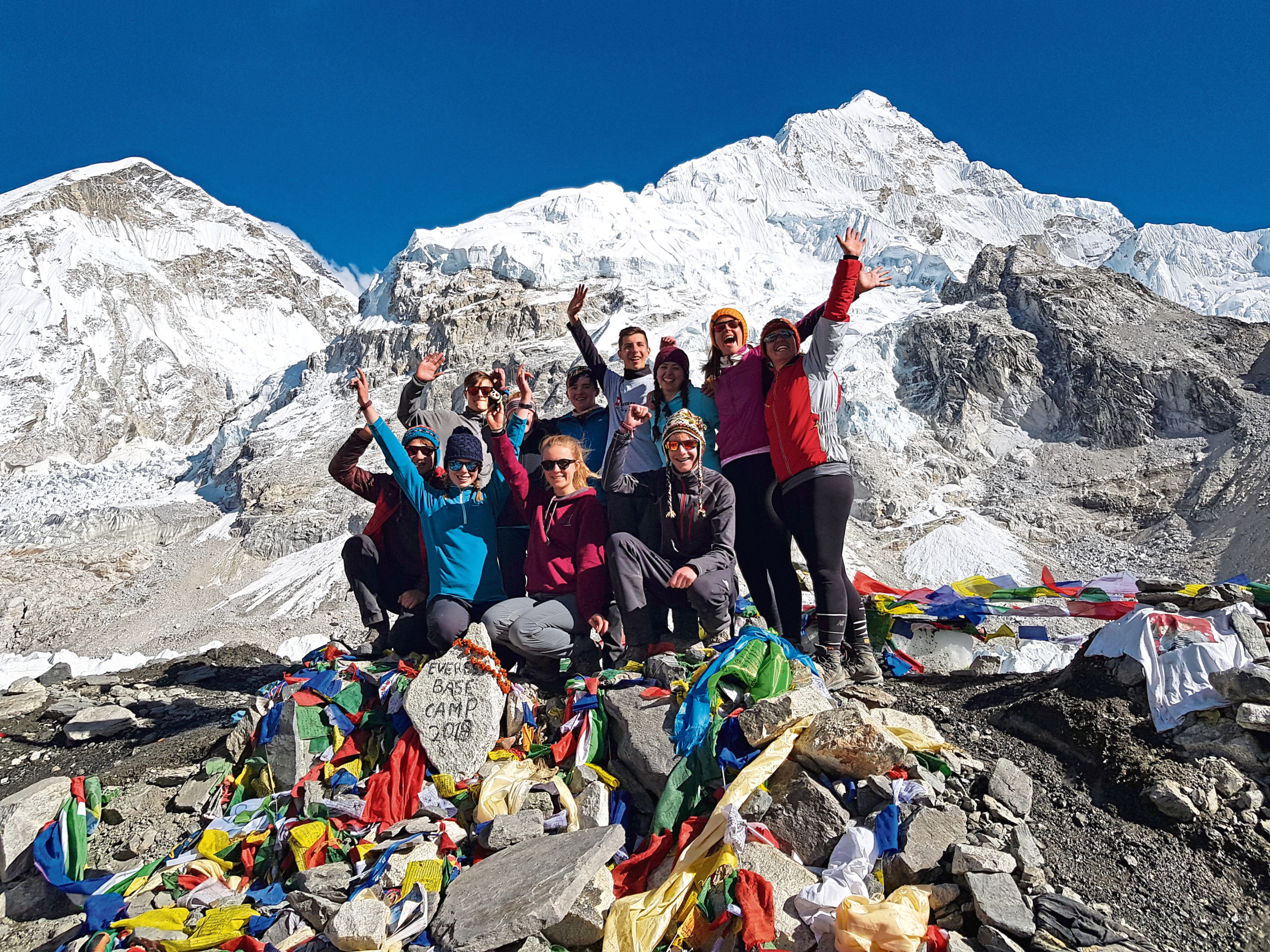 The pupils and staff from Albyn School at Everest Base Camp after their achievement
