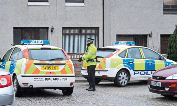 Police officer at the front of the house on Stornoway Crescent, where the incident took place in 2008