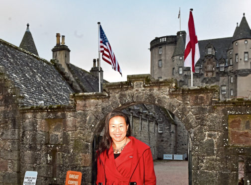 Castle Fraser with the American flag flying in the background