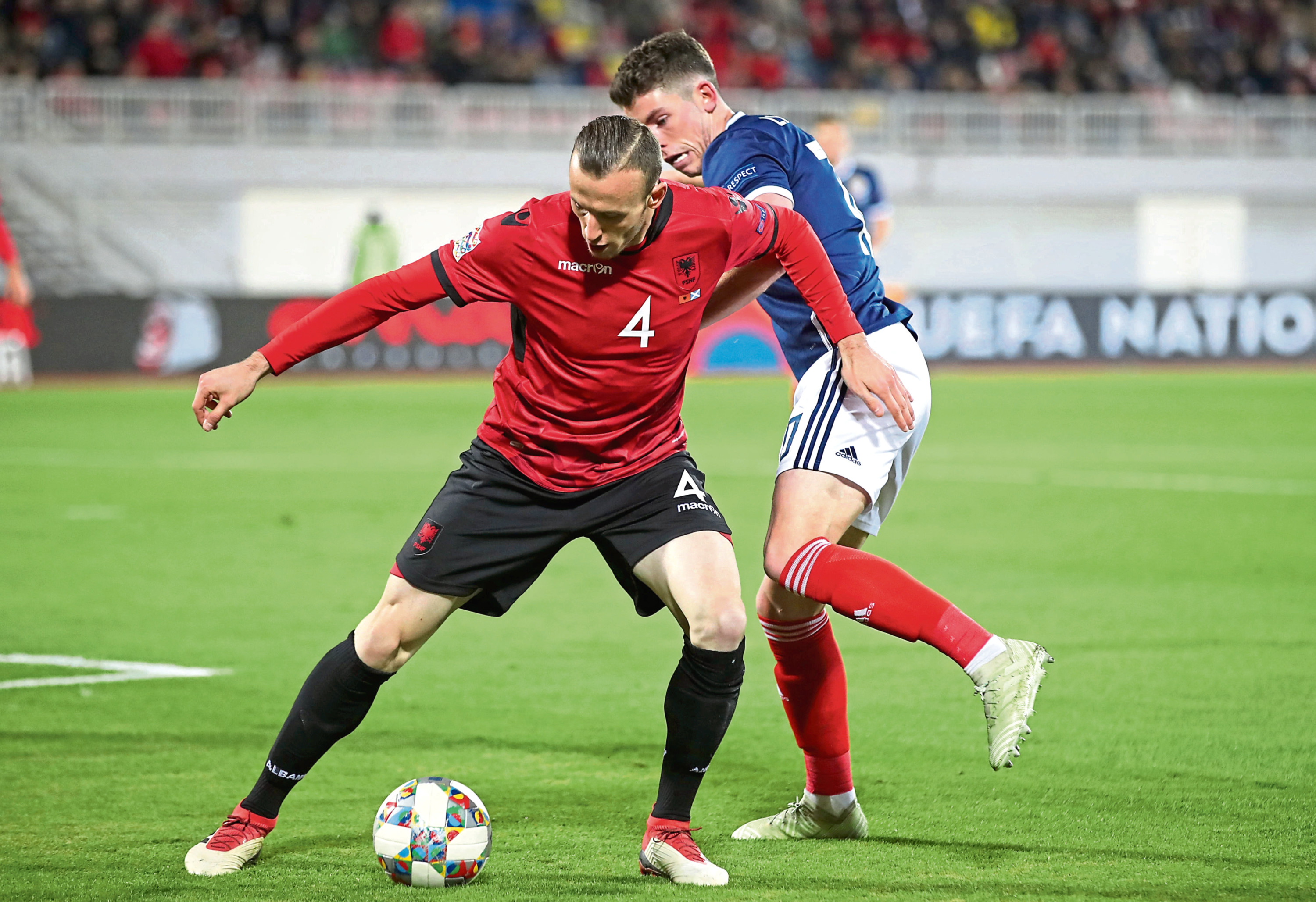 Albania's Adrian Ismaili (left) and Scotland's Ryan Christie battle for the ball during the UEFA Nations League game in Shkoder.