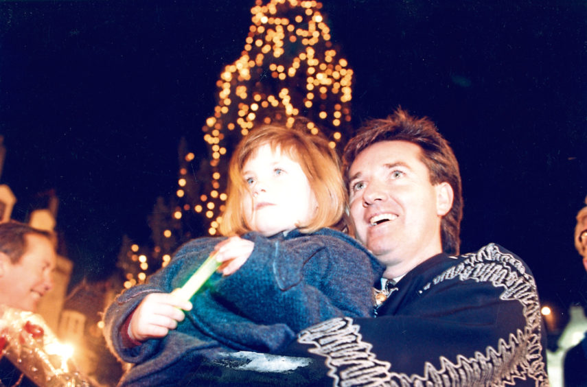 1995: Stephanie Keenan, 5, was singer Daniel O'Donnell's choice of companion to switch on Aberdeen's Christmas lights