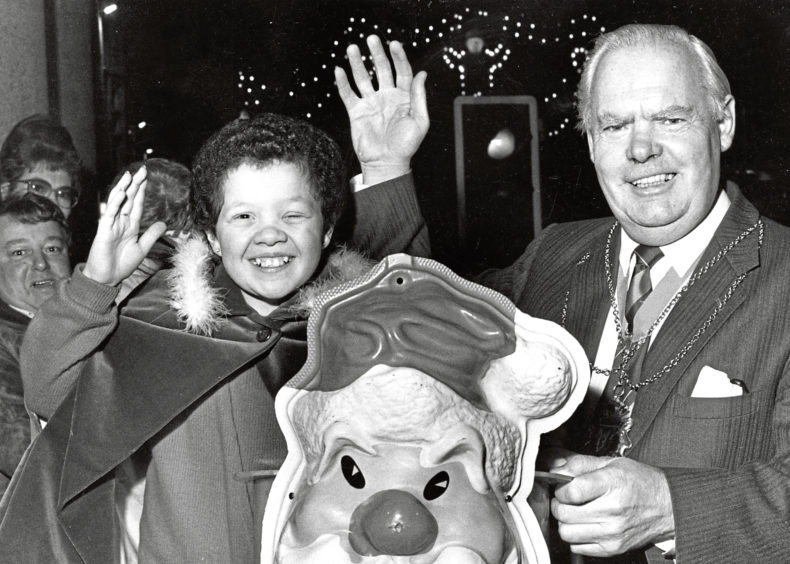 1986: Lord Provost Henry Rae and Susan Henderson after she officially switched on the Christmas lights