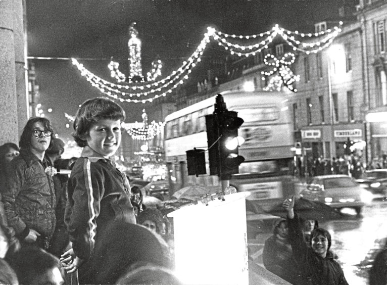 1977: Gordon Fraser, 11, pulled the switch that turned on the Christmas lighting display