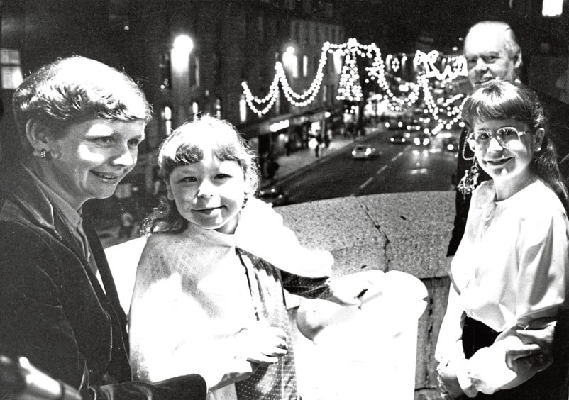 1984: A proud moment for Jill Hird as she presses the button to switch on the Christmas lights in Aberdeen – from left, Jill's mother Linda, Jill's sister Alison, 11, and Lord Provost Henry Rae
