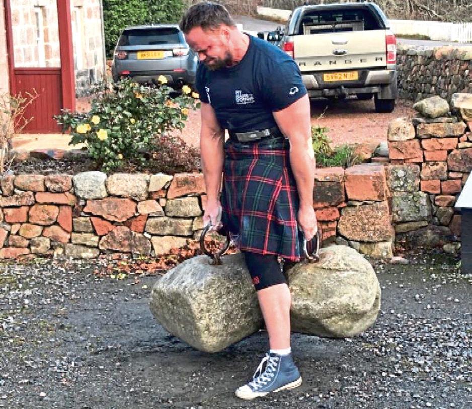 Sebastian Hunt lifting the Dinnie Stones