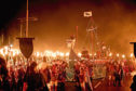 Members of the Jarl Squad carry flaming torches through Lerwick on the Shetland Isles during the Up Helly Aa Viking festiva