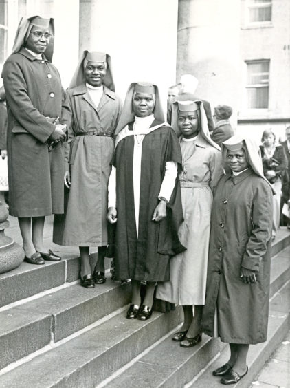 1975: Sister Camillus, centre, with her fellow Nigerian nuns after she received her Certificate of Health Visiting