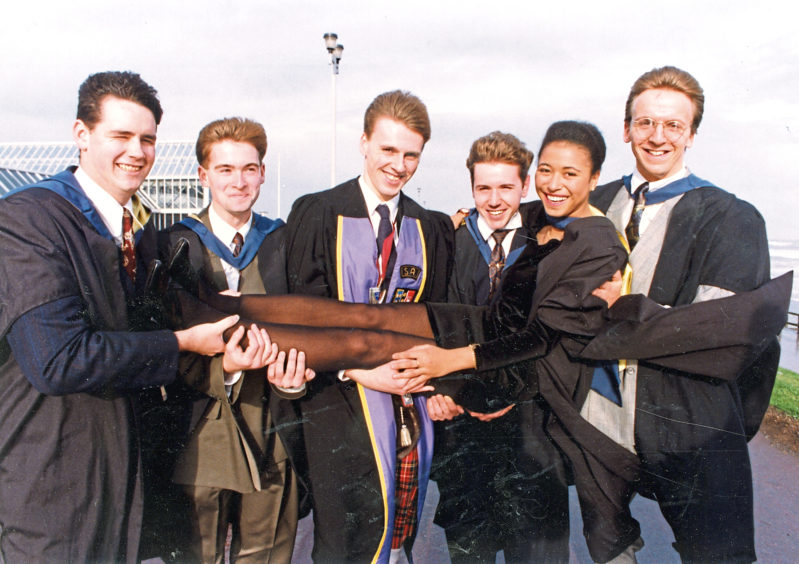 1991: Building surveying graduate Angelique Omotosho gets a lift from her classmates, from left, Gary Black, Chris Martin, Terry Wiggins, Gregor Stewart, and Tim Dale