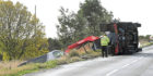 The crashed van and overturned recovery vehicle on the B999