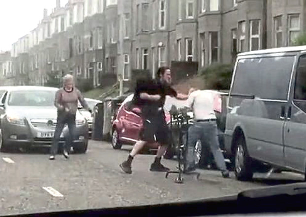 A screenshot from footage showing Steven Gault punching the pensioner