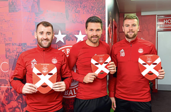 Niall McGinn, Tomas Cerny and Michael Devlin have got their masks