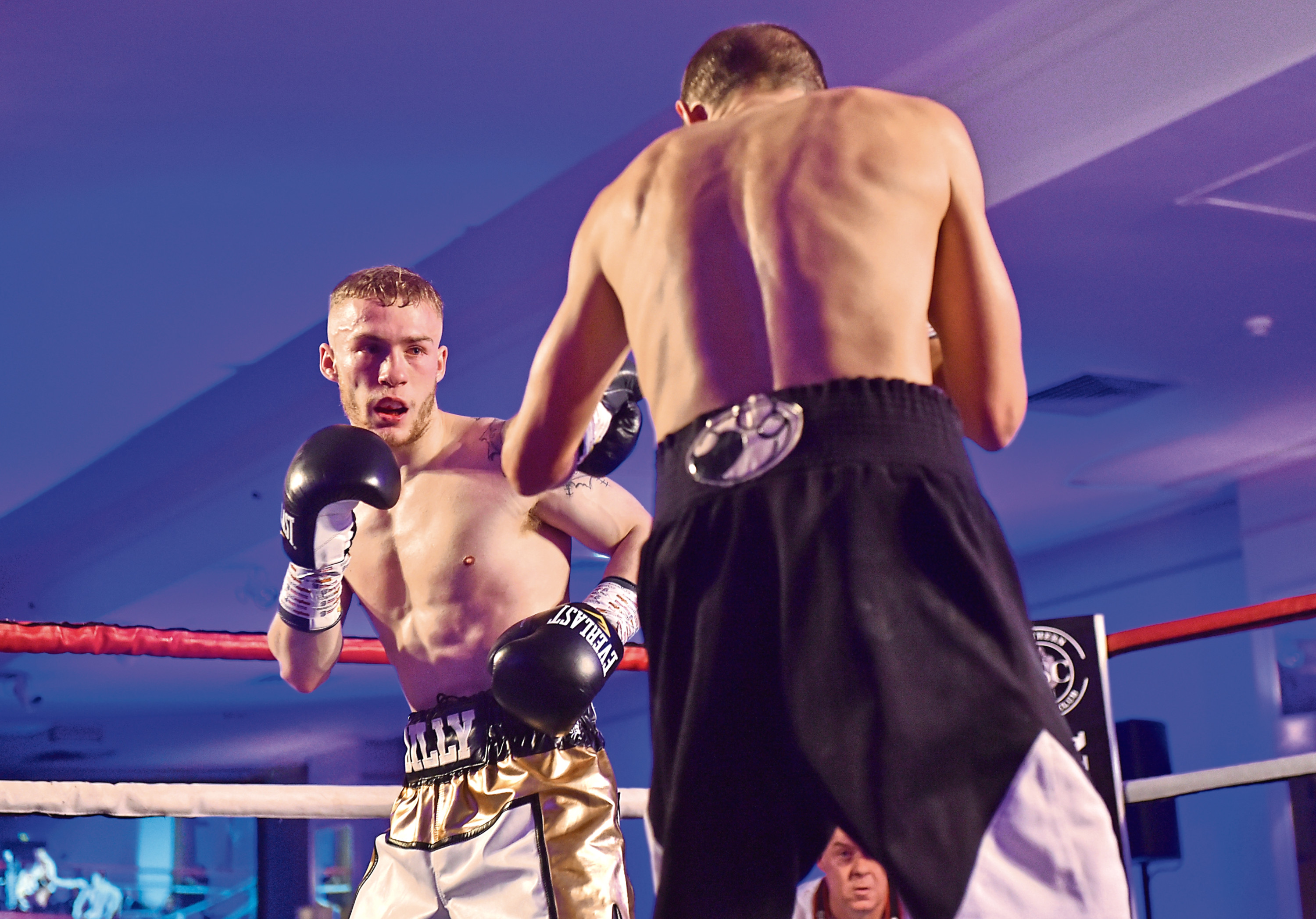 Pictured is Billy Stuart (Gold Shorts) v Dmytro Kostenko. Picture by Scott Baxter
