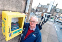 Stonehaven Community Council Chairman Raymond Christie at the defibrillator