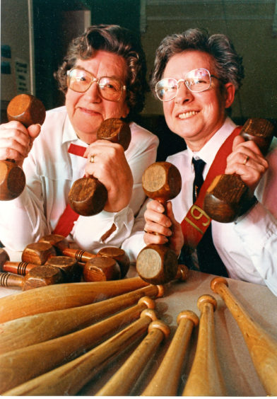 1992: Myra McDonald, left, and Isabel Davidson of the 19th Company Girls Brigade get to grips with some equipment which was around in their younger days