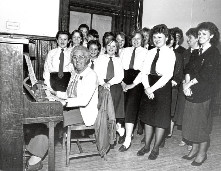 1987: Torry Church 24th Girls' Brigade rehearsing with pianist Bess Watkins for the divisional choir competitions