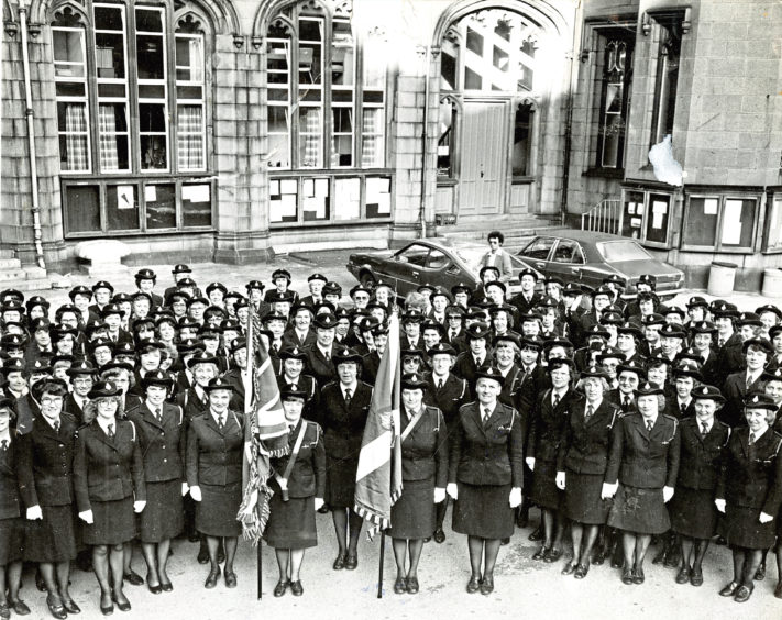 1979: Girls' Brigade members pose for a picture in Marischal College Quadrangle before their national annual meeting parade to the North Church of St Andrew, Aberdeen