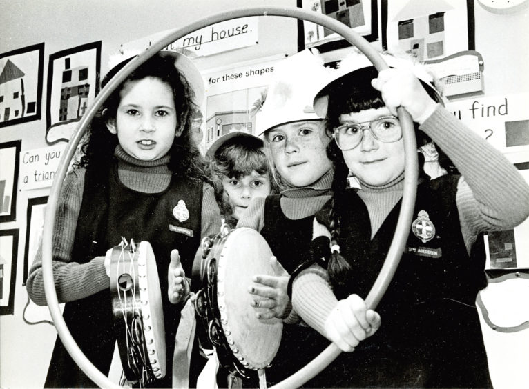 1985: Sara Smith, Angela Brown, Caroline Clarkson and Gillian Pearson of the 31st Middleton Park Church Girls' Brigade get ready to entertain visitors to their open night at Middleton Park Primary School