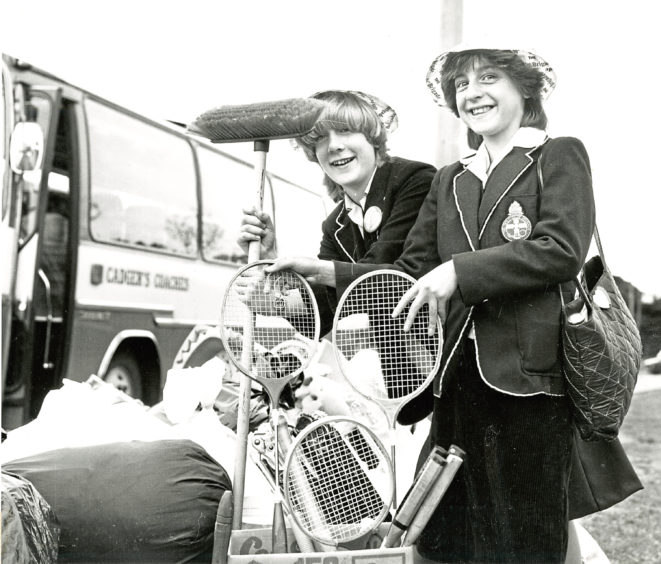 1982: 1st Ellon member Moira Robertson, left, and Pamela Wyness, 9th Aberdeen, make sure the sports gear is safe as they get ready to pack their coach